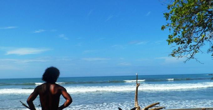 Rony Obando (www.surfschoolpuravida.com) checking the waves at playa Dominicalito.