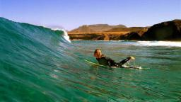 Surfer Girl of Nalusurf Surfschool Fuerteventura