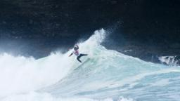 Kieran Bulard surfing at Piha in New Zealand