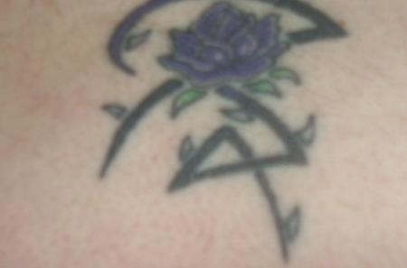 Ive got this purple rose and celtic tat at the bottom of my back ive got a