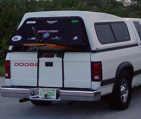 best way to keep board from flying out of pickup truck bed?